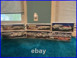 Lot of 14 HESS trucks. All new in box. Never displayed